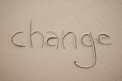 Change Simple Word in Sand Horizontal Handwritten Outdoors